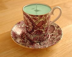 Homemade candle. Melt dollar store candles with scent/color and put into thrift store tea cups.