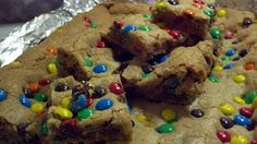 These are the M&M cookie bars I made from the recipe that is floating around on Pinterest - the recipe is a winner and the kids loved them. SO simple! NO mixer required. http://lizzygoesdutch.blogspot.com/2010/06/thick-and-chewy-m-cookie-bars.html