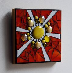 Mosaic sunburst wall hanging with yellow glass beads, mirror, and orange stained glass. on Etsy, $30.00