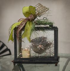 This lantern is perfect for a winter display. Notice the tiny lights.