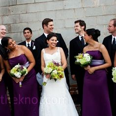 bridesmaids wore elegant, floor-length gowns in a deep shade of purple with contrasting pale purple sashes. To complement the look, the guys wore purple vests and ties with subtle pinstripes.