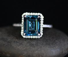 London Blue Topaz Engagement Ring Topaz Halo Ring in 14k White Gold with London Blue Topaz Emerald Cut 10x8mm and Diamond Halo by Twoperidotbirds on Etsy https://www.etsy.com/listing/207097089/london-blue-topaz-engagement-ring-topaz