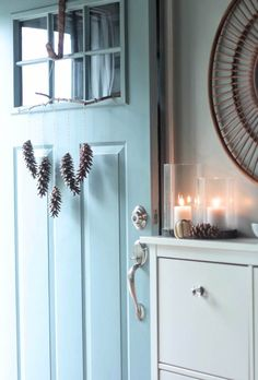 Celebrate the season with a pinecone wall hanging.