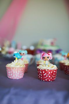 lalaloopsy cupcakes decorated with the pencil toppers that I already have all over this house.  Brilliant.