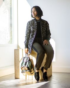 Wilfred Free preowned fall leopard coat with olive joggers, loafers and vintage backpack. Elyse Bouvier