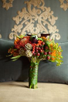 Wedding bouquet with berries and protea | Harvest Hue Seattle Rooftop Wedding | Photograph by Vanasse Studios http://storyboardwedding.com/harvest-hue-seattle-rooftop-wedding/