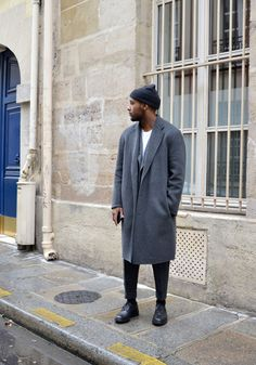 Not too big of a fan on the coat's looser fit although I get it. Those cropped pants are fire again. Also, black minimalistic derbies.