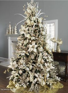 I cannot seem to get into Christmas trees being decorated with feathers and all this junk but this one...I almost...almost like.  Probably because it's all white.  What is my obsession with all decor being white??
