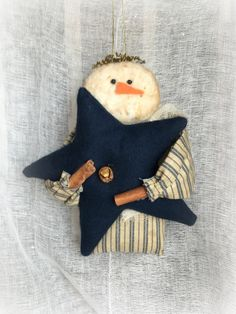 Primitive Snowman Ornament with Star by CozyExpressions on Etsy