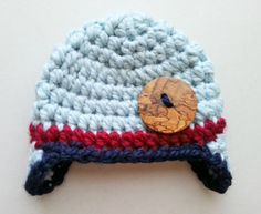 #31 of 100 - crochet newborn hat with earflaps - button is from: https://www.etsy.com/shop/watercolorsnmore