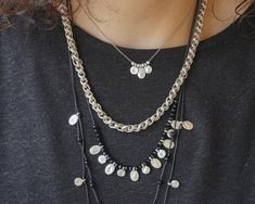 A unique set of three necklaces with multiple round and oval motifs, small round beads, black crystals and stainless steel chain. It's special and perfect for a fresh and modern look.  The two longer necklaces have its own macrame knot as closure for adjustable height and to mix & match them with Rock Jewelry, Evil Eye Necklace, Macrame Necklace, Short Necklace, Stainless Steel Chain, Black Crystals, Mix Match, Round Beads, Rose Gold Plates