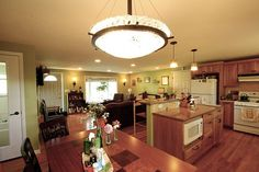 Open concept kitchen with Universal Design features by McClurg.