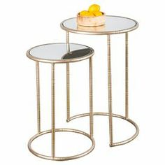 "Featuring mirrored tops and golden finishes, these elegant nesting tables offer the perfect surface for resting canapes and cocktails at your next soiree.  Product: Small and large nesting tableConstruction Material: Iron and mirrored glassColor: GoldDimensions: 23"" H x 16"" Diameter (large)"