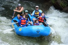 This family's getting excited as they go through a rapid on the Nantahala River with Wildwater.