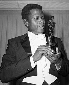 """Actor Sidney Poitier is photographed with his Oscar statuette at the 36th Annual Academy Awards in Santa Monica, Calif. on April 13, 1964. He won Best Actor for his role in """"Lillies of the Field."""" (AP Photo) Photo: Anonymous"""