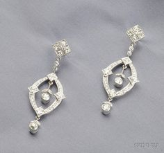 Platinum and Diamond Earpendants, of navette form, set with old European and full-cut diamonds, approx. total wt. 2.38 cts., millegrain accents, lg. 1 3/4 in.