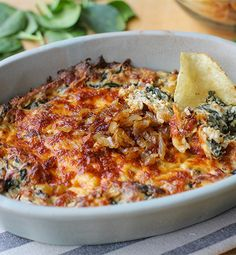 Created by: Julia Mueller, The Roasted Root   	Warm, creamy and cheesy, this caramelized onion dip will have your guests flocking to the table!