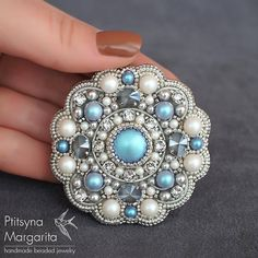 Bead embroidery brooch Blue Kaleidoscope in light blue and silver colors This order brooch is embroidered with Swarovski crystals and pearl, japanese seed beads and french wire. Backside is covered with Ultra Suede (faux suede) The brooch is embroidered with silver plated and