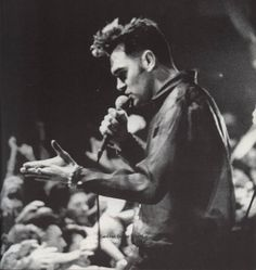 Morrissey performing on stage during his 'Kill Uncle' tour, 1991.
