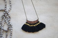 Multi Tassel Wooden Pendant Black and Gold Necklace by blendingbybetty on Etsy https://www.etsy.com/listing/481420569/multi-tassel-wooden-pendant-black-and