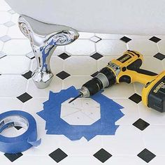More tips here for replacing our broken porcelain tile in the bathroom, like drill the tile first to help with breaking it up.