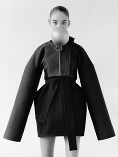 Contemporary Fashion Design - black coat with exaggerated silhouette // Paco Rabanne