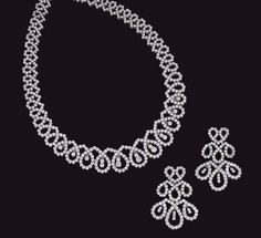 A SUITE OF DIAMOND JEWELLERY Comprising a necklace designed as a graduated line of circular-cut diamond oval loops, the front section with central pendants, cm., and a pair of ear pendants en suite, mounted in white gold Filigree Jewelry, Diamond Jewellery, Diamond Necklace Set, Diamond Studs, Wedding Jewellery Designs, Jewelry Design, Gold Temple Jewellery, India Jewelry, Luxury Jewelry