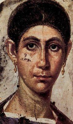 Retrato de una mujer con aros.