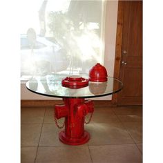 An old fire hydrant turned into a coffee table. Another great use of reusing old fire equipment & tools. #DIY #firehydrant #firefighter