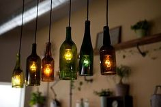 sticks and bricks » the roost – glass bottle hanging lamps.  cut the bottoms off with a tile saw!