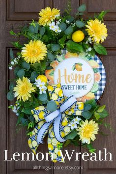 This lemon grapevine wreath is perfect for your spring and summer decor! It has bright lemons tucked into a grapevine base surrounded by various greenery, daisies, and lemons topped off by a gorgeous black and white check lemon bow. It screams refreshing for this spring and summer! Lemon Wreath, Lemon Top, Spring Door, Summer Wreath, Door Hangers, Grapevine Wreath, Grape Vines, Greenery, Wreaths