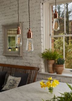 Hanging three copper pedant lamps from the ceiling over the kitchen island with three Flexible LED Filament Lamps creates a beatiful and stylish effect with lovely ambiant light.
