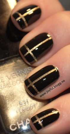 cross nails (black and gold) . Makes me think of a super chic Christmas present . Like a sleeker Tiffany's Box !