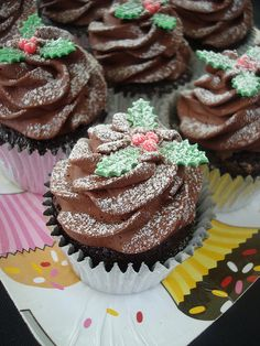 Now these little Christmas cupcakes are festive and something even I could make, unlike some of the other (beautiful) over the top cupcakes I've seen lately.  ;)