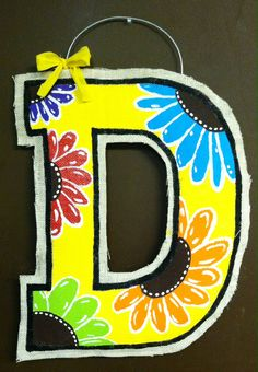 Dusti's hand painted burlap door hanger I made...I love how the yellow pops :))