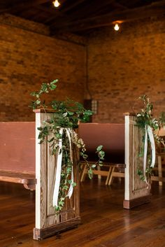 Dress up the sides of our pews with a little greenery and ribbon and they are just darling! Aisle Markers, Rustic White, White Photography, Greenery, Floral Design, Ribbon, Table Decorations, Chair, Flowers