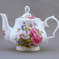 """Pink Rose is a delightfully feminine English pattern that features bold pink roses with soft hues of blue and white floral accents. A touch of greenery in the background makes the pattern even more alluring. Floral patterns are commonly used at English tea parties and """"Pink Rose"""" is beautifully refined and elegant for such an …"""