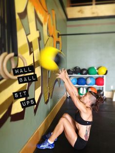 Wall Ball Sit Ups: With your feet next to a wall, lay in a starting sit up position with hands overhead holding a medicine ball. As you sit up (FAST) use your moment to throw the ball as high as you can against the wall. Catch and lay back down.