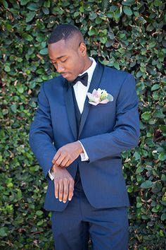 Chuck Jones Center for Creativity Wedding Groom is in a Navy Tuxedo with Black Bow Tie groom in navy tuxedo with pink boutonniere Blue Prom Tux, Navy Blue Tux, Blue Tuxedo Wedding, Pink Tuxedo, Wedding Suits, Wedding Attire, Wedding Groom, Navy Suits, Wedding Poses