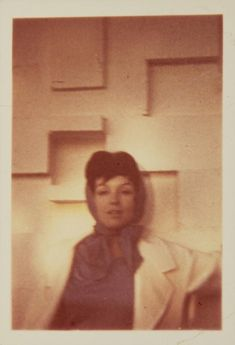 """Marilyn Monroe Incognito Snapshot   A small color snapshot of Monroe wearing a brunette wig and scarf around her head in disguise. A number of stories have been told regarding Monroe dressing in a brunette wig and going out to bars to see how men responded to her when she wasn't """"being"""" Marilyn. This image documents Monroe as she appeared in a brunette disguise."""