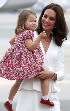 Catherine, Duchess of Cambridge was looking radiant in a white Alexander McQueen coat dress while the two-year-old Princess Charlotte of Cambridge looked adorable in a floral dress teamed with red shoes and white socks, as she smiled in her mother's arms and waved to onlookers