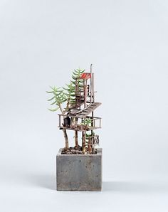 Miniature Treehouse Sculptures Built Around Houseplants by Jedediah Voltz
