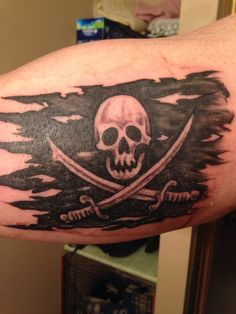 Pirate flag tattoo!! This tattoo is fantastic and originally done. It's has a skull and swords and it is a tattered flag. Ps dick faces who don't like the description Pinterest mAde me do it