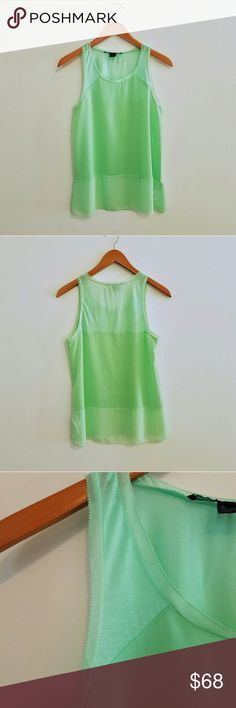 """French Connection Mint Green Sleeveless Blouse Light green sleeveless blouse by French Connection. Color is similar to a mint green. The top is trimmed with chiffon. Like new condition.   Size S  Measures approximately: Underarm to underarm - 17.5"""" Shoulder to shoulder - 11.5"""" Front - top to hem at the middle - 20"""" Back - top to hem at the middle - 24.5"""" French Connection Tops Blouses"""