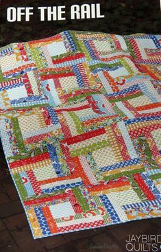 """Quilt Pattern by Julie Herman of Jaybird Quilts includes complete instructions to make the Off the Rail quilt in 4 sizes. Fabric not included. Baby quilt - 41"""""""
