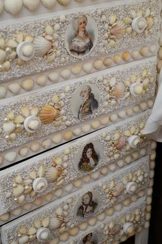Lisa Mende Design: Kit Kemp at Decorex International with Blogtour London ~ Detail shot of the cameos on the drawer fronts of the shell encrusted bedside chest by Chelsea Textiles