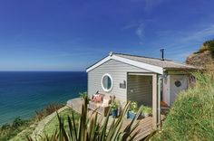 Nicknamed The Edge, the cottage sits atop a cliff with a stunning view of Whitsand Bay in Cornwall, United Kingdom.