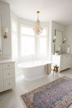 modern farmhouse bathroom design with boho rug, white hex tile floor and white vanity in traditional bathroom, white cottage bathroom, farmhouse bathroom with white subway tile, free standing bathtub Bad Inspiration, Bathroom Inspiration, Bathroom Ideas, Mint Bathroom, White Master Bathroom, Bathroom Black, Master Bathrooms, Bathroom Designs, Master Bathroom Layout