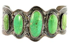 Navajo Fred Harvey sterling silver and green turquoise cuff bracelet. Bezel set with five natural green turquoise stones. Hand-stamped