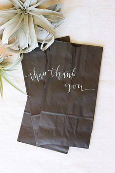 black bags, white calligraphy
